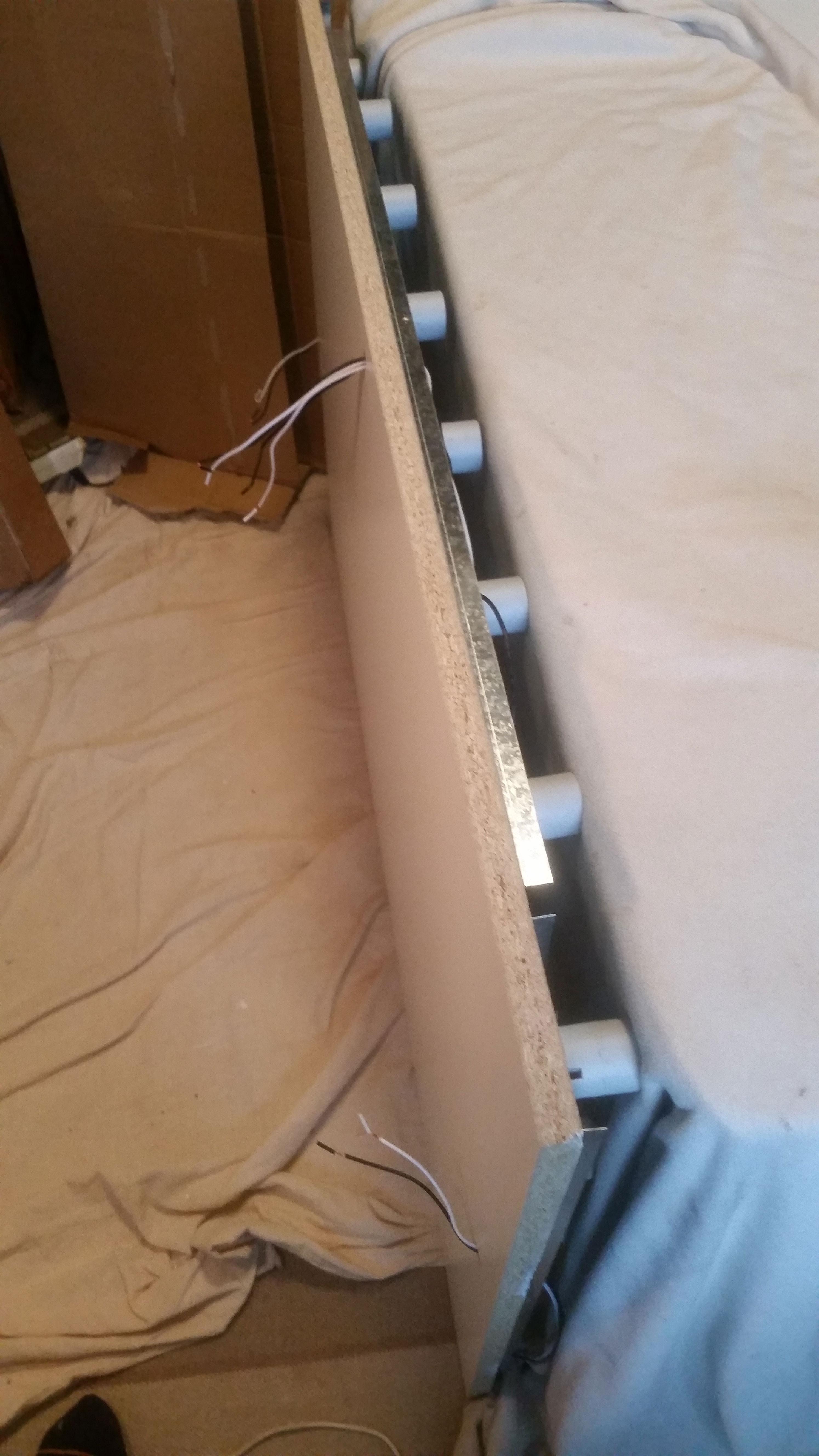 Board leaning against padding